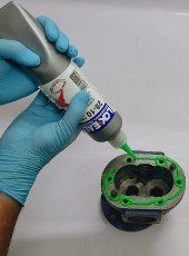 Application of Loxeal 28-10, anaerobic gasketing adhesive over flange surface