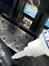 Application of Loxeal instant adhesive in an automotive production line