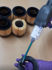 Application of Loxeal 31-40, clear, self leveling adhesive, dispensed using Cox MR dispenser